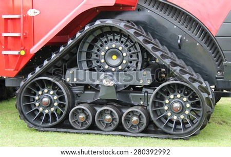 The Drive Track of a Heavy Duty Agricultural Tractor. - stock photo