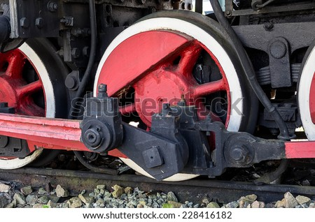 The drive wheels of an old steam locomotive - stock photo