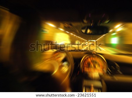 The driver in car in a tunnel - stock photo