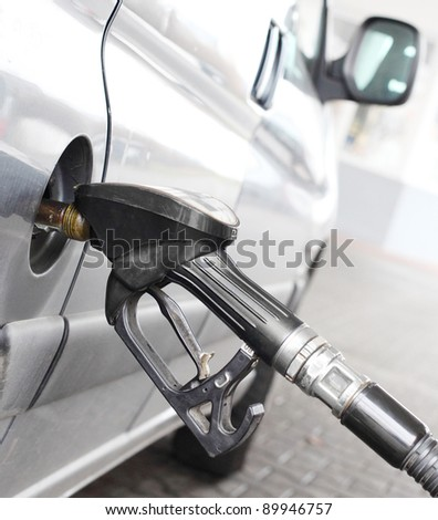 The driver pumping gasoline at the gas station. - stock photo