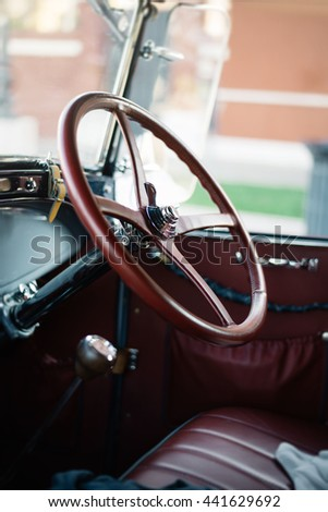 the driver's seat of an old car