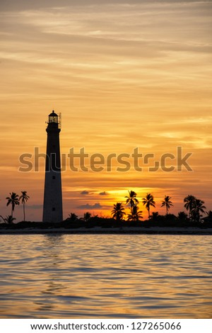 The Dry Tortugas lighthouse on Loggerhead Key during sunset - stock photo