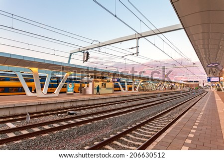 The Dutch Arnhem railway station during sunset - stock photo