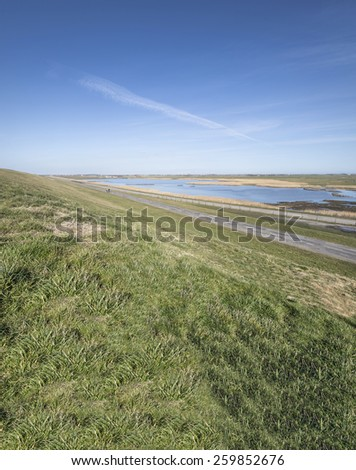 The Dutch Dike. A day in spring. - stock photo