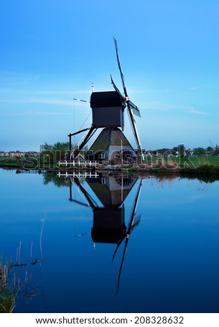 The dutch windmills at Kinderdijk in the Netherlands, an UNESCO world heritage site. - stock photo