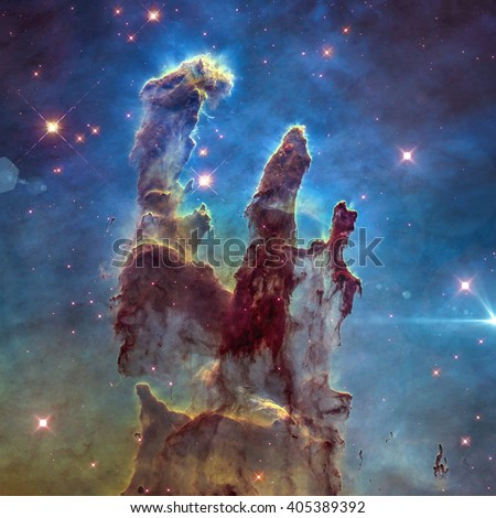 The Eagle Nebula's Pillars of Creation. Retouched image. Elements of this image furnished by NASA. - stock photo