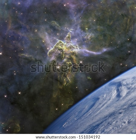 The Earth against the Carina nebula. Elements of this image furnished by NASA.