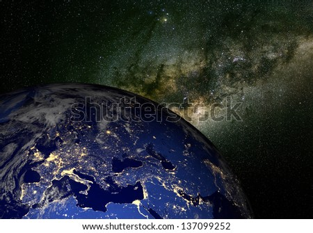 The Earth from space at night and the Milky Way. Elements of this image furnished by NASA. Other orientations available. - stock photo