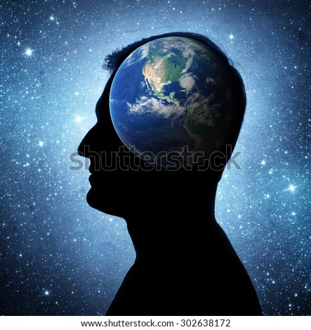 The earth within. Silhouette of a man inside the universe. The concept on scientific and philosophical topics. Elements of this image furnished by NASA. - stock photo