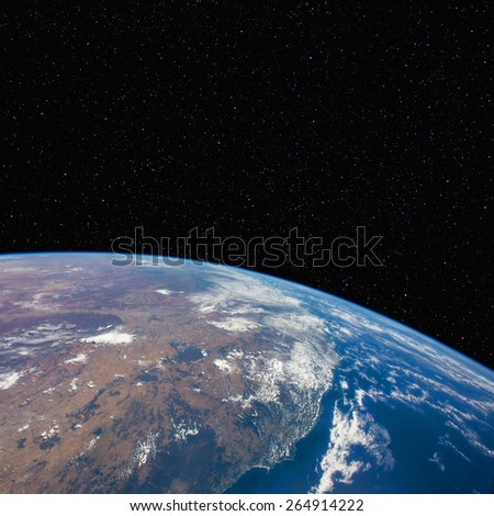 The east coast of Australia (Newcastle to Brisbane)  from space with stars above. Elements of this image furnished by NASA.  - stock photo