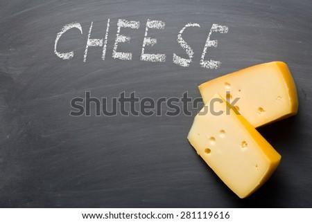the edam cheese on blackboard - stock photo