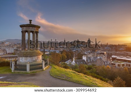 The Edinburgh skyline with the Edinburgh castle in the background. Photographed from Calton Hill at sunset. - stock photo