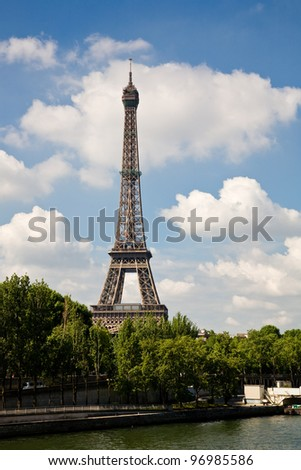 The Eiffel Tower in Paris seen from the river Seine