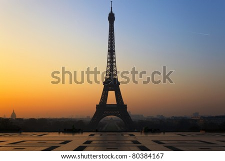 The Eiffel Tower in Paris, seen from the Trocadero at sunrise. - stock photo