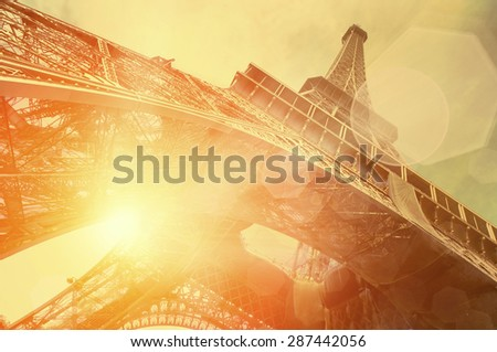 The Eiffel tower is one of the most recognizable landmarks in the world under sun light - stock photo