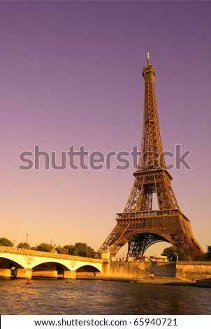 The Eiffel Tower over the River Seine in Paris, France - stock photo