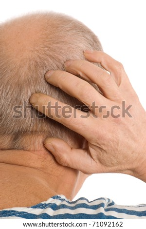 The elderly man scratches a nape - stock photo