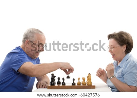 The elderly pair playing chess on white background - stock photo