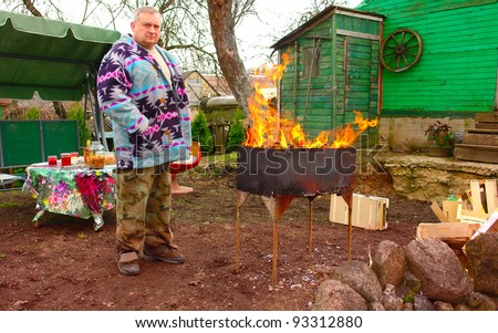 The elderly tired men is cleaned in a court yard of the house - stock photo