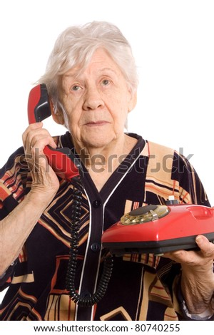 The elderly woman speaks on the phone - stock photo