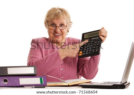 The elderly woman with the calculator - stock photo