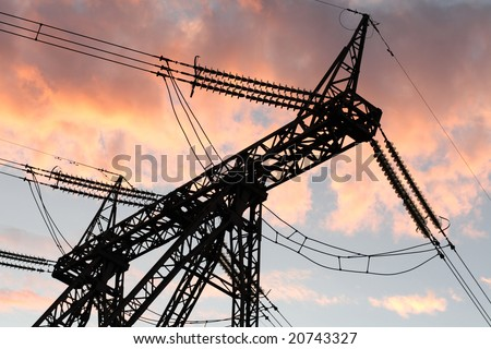 The electric line on sky background at sunset - stock photo