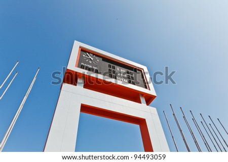 The electric scoreboard and the flagstaff with the blue sky background - stock photo