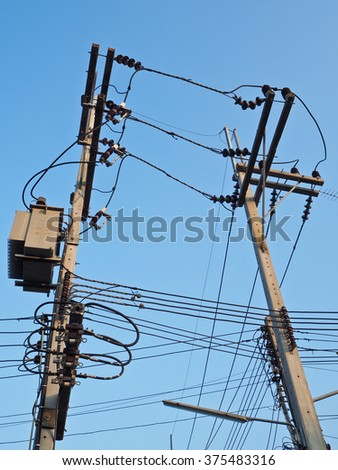 The electricity post with blue sky.