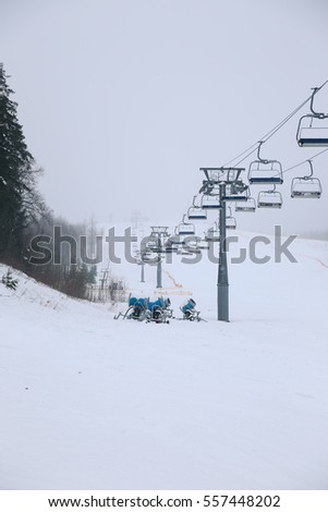 The elevator in ski resort in the winter in foggy weather