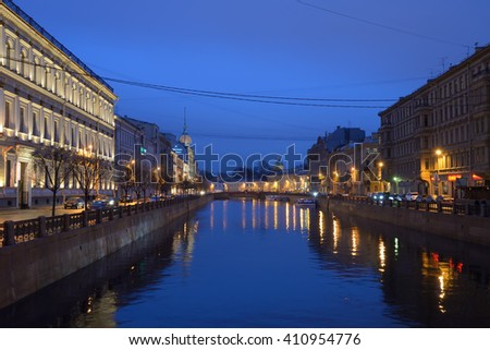 The embankment of the river Moika at night after rain, view from the Blue bridge in St. Petersburg