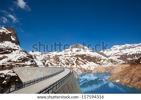 The Emosson hydroelectric Dam near village of Chatelard, Swiss on the border with France at spring - stock photo