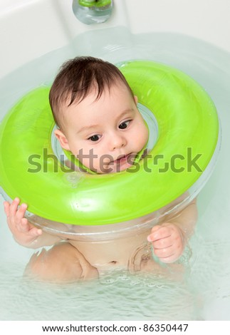 The emotional delightful child taking a bath - stock photo