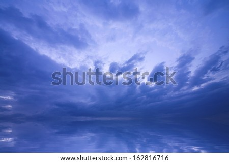 The empty and clouds which are reflected in the water surface