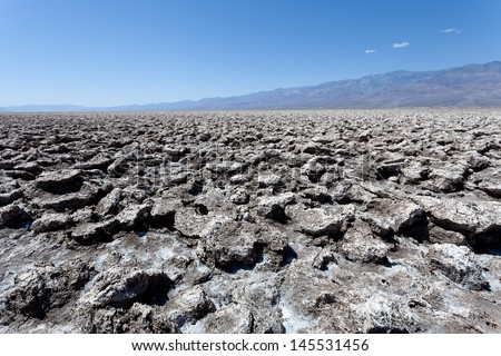The empty salt pan of Devil's Golf Course in Death Valley, CA. - stock photo
