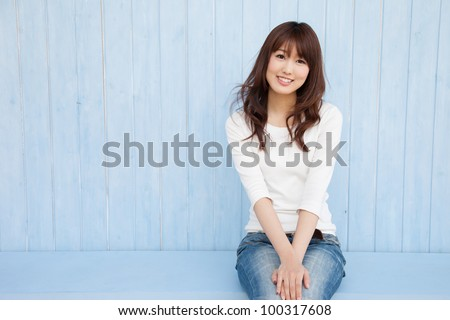 The empty space in the blue background of Asian women and fluttering hair