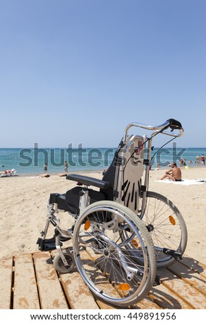 The empty wheelchair in the background of the sea.