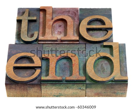 The end concept - words in vintage wooden letterpress printing blocks, stained by color inks, isolated on white - stock photo
