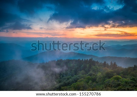 The end of the day brings the distant light across the Appalachian  Mountains on the Blue  Ridge Parkway in Western North Carolina. - stock photo