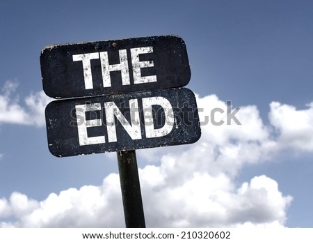 The End sign with clouds and sky background  - stock photo