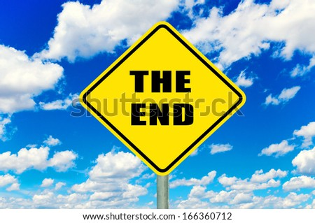 The end yellow road sign with clouds and sky in background - stock photo