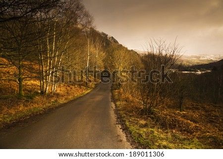 The English Lake District, bathed in a beautiful burst of late afternoon winter sunshine.  - stock photo