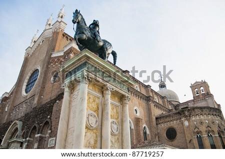 The enormous Colleoni statue, dating from 1496, dominates the Campo di Santi Giovanni e Paolo at Venice, Italy - stock photo