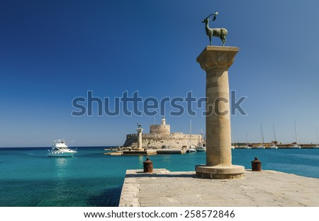The entrance to the harbor in Rhodes greece - stock photo