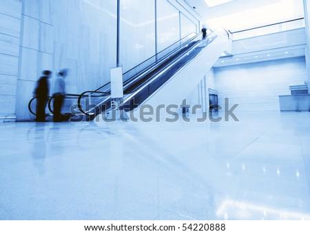 The escalator inside the building - stock photo