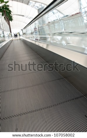 The escalator moving in airport - stock photo