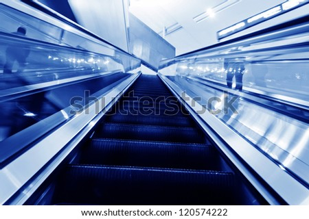 the escalator of the subway station in beijing china. - stock photo
