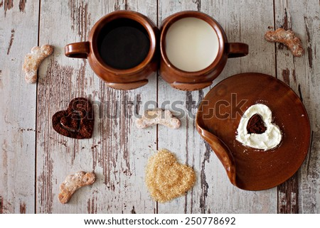 The essential of the day, coffee, milk and sugar, valentine concept, cookies - stock photo