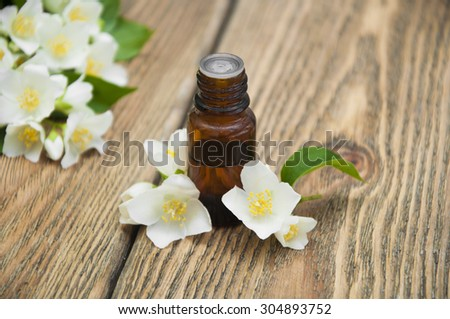 The essential oil of jasmine on wooden background