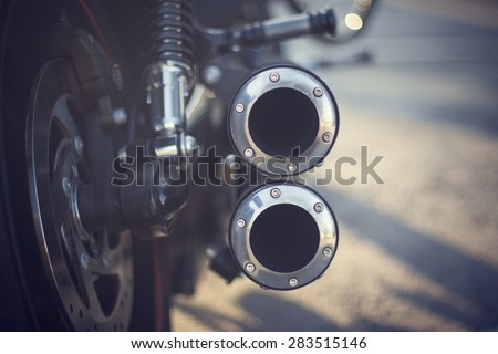The exhaust of the legendary bike. - stock photo