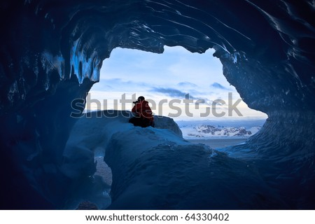 The exit from blue cave in Antarctica - stock photo